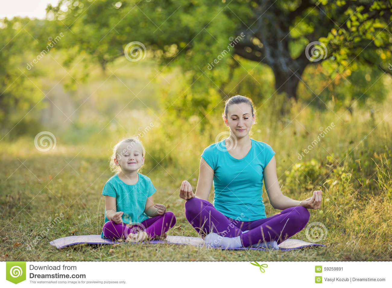 Mom And Child In The Lotus Position Stock Photo - Image ...