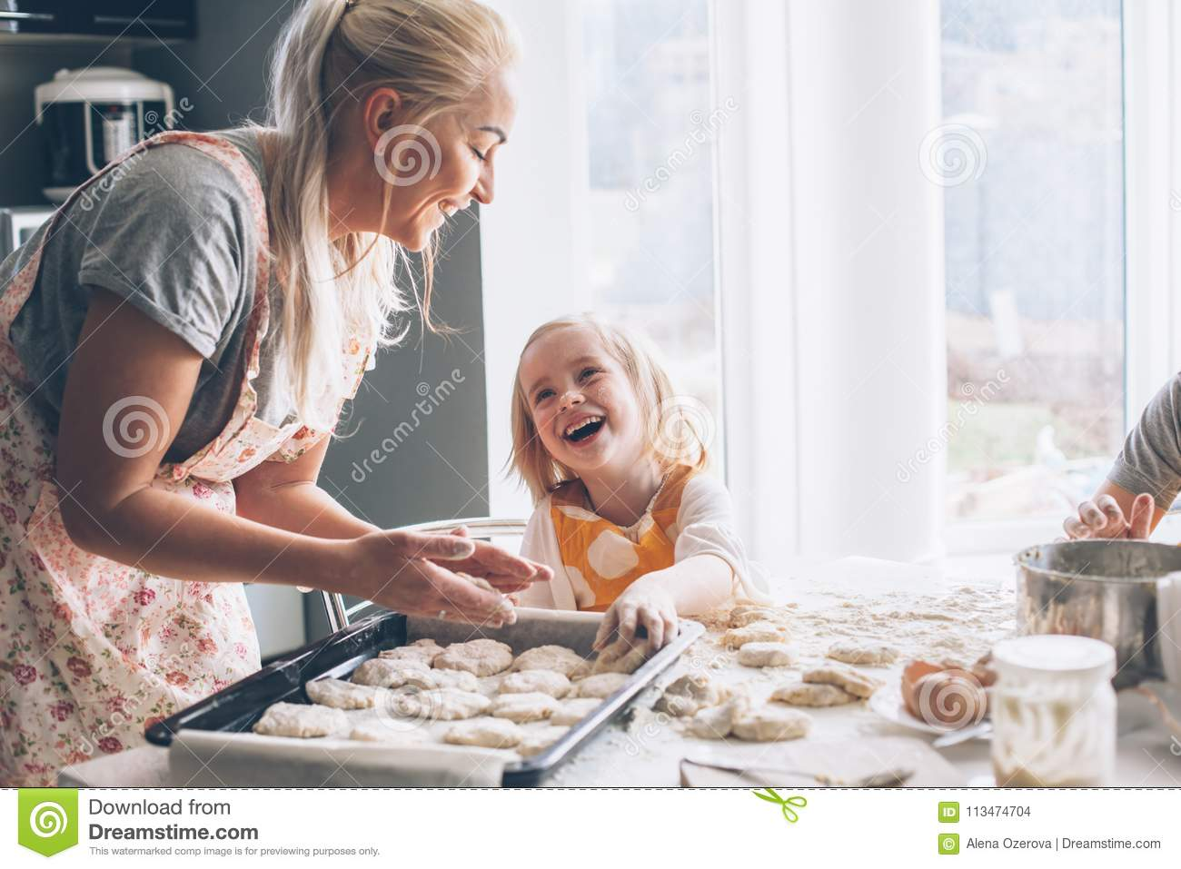Mom Cooking With Daughter On The Kitchen Stock Photo - Image of ...