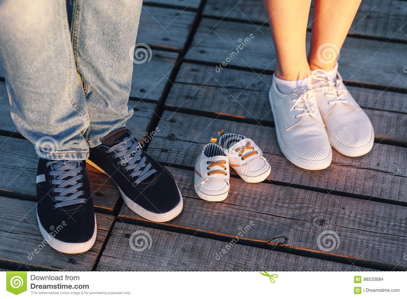 866f65426a2ee Mom, Dad And The Future Baby Shoes Stock Photo - Image of maternity ...