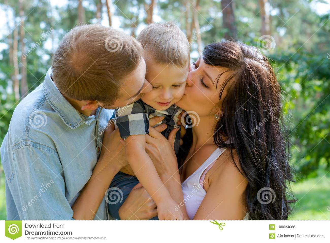 mom and dad hug and kiss their baby stock photo - image of kids