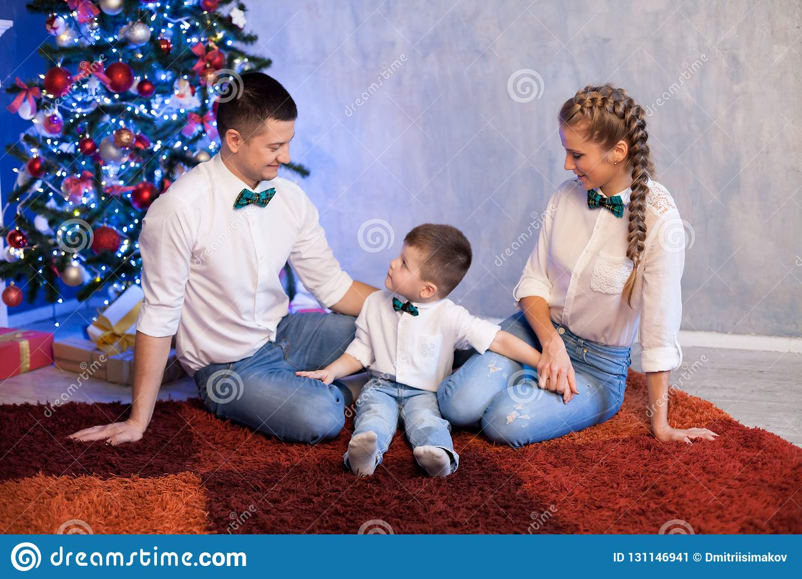 Mom Dad And Son New Year Holidays Christmas Tree Gifts Stock