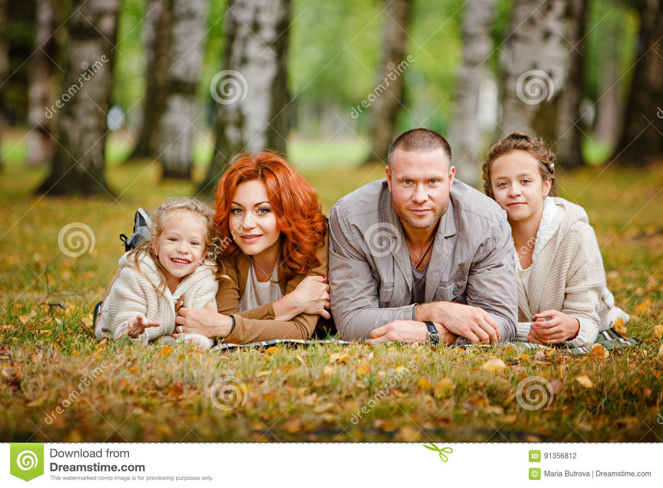Mom, dad and two charming sisters in the same curly beige knit s