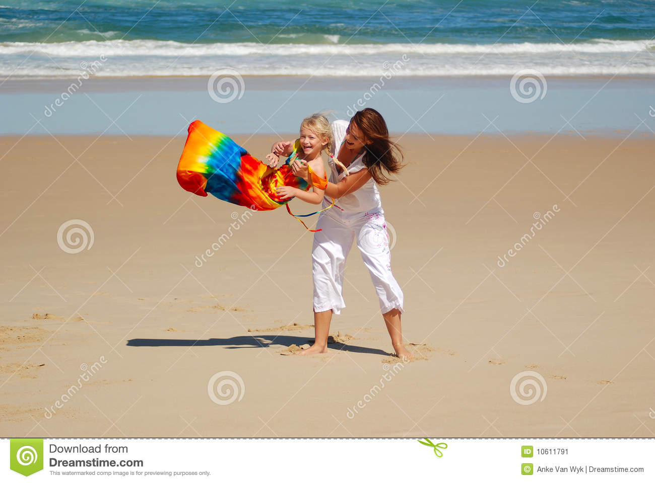 Mom, daughter, beach fun