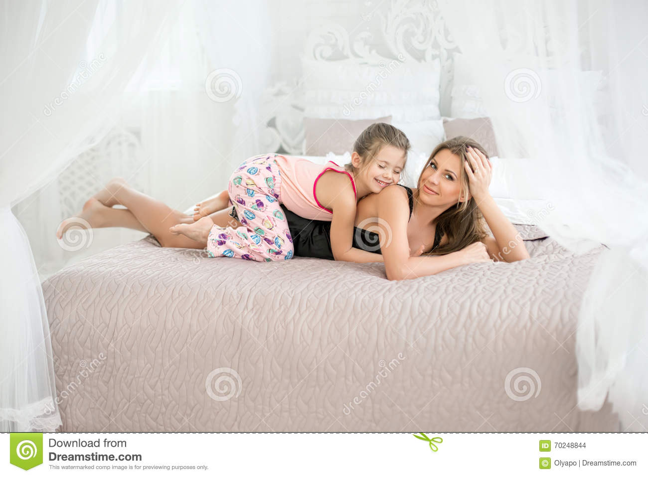 MILF and doughter on the bed