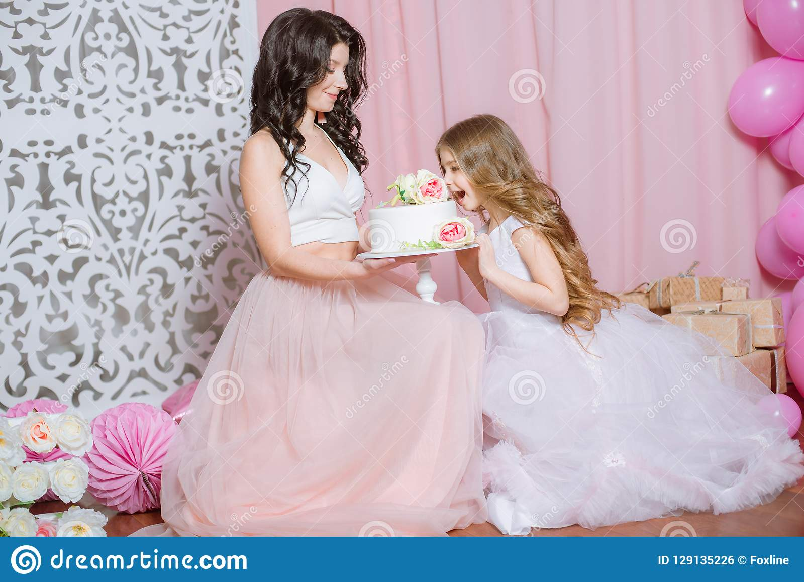 Mom And Daughter Celebrate Their Birthday With Pink Balloons