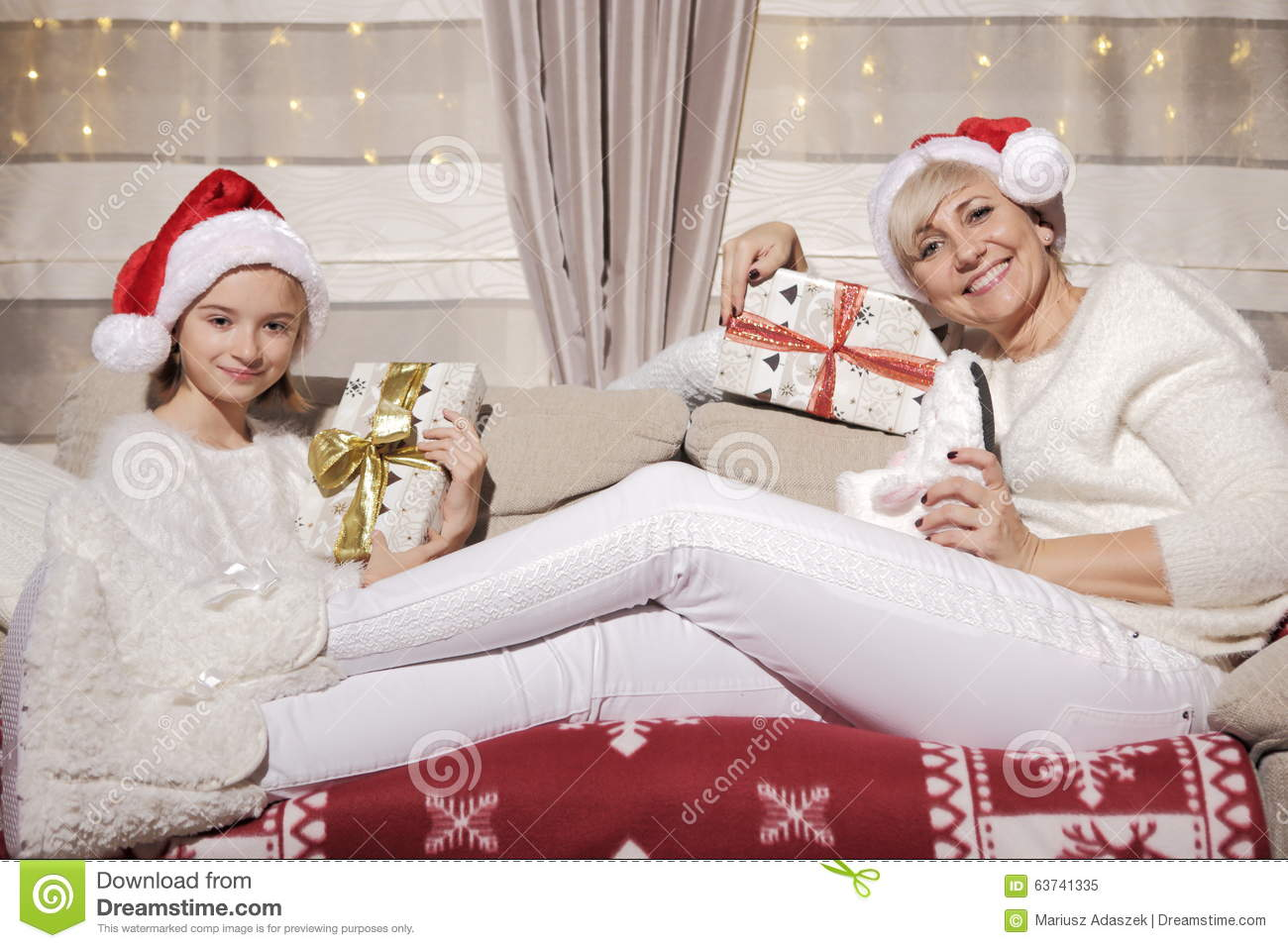 Christmas Presents For Mom From Daughter.Mom And Daughter On The Couch With Presents Stock Image