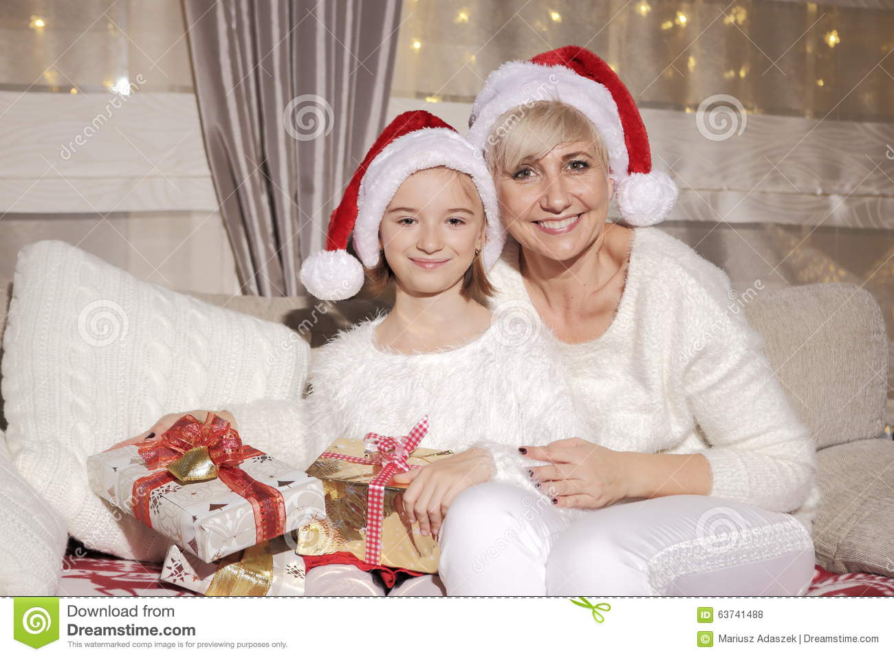 Christmas Presents For Mom From Daughter.Mom And Daughter On The Couch With Presents Stock Photo