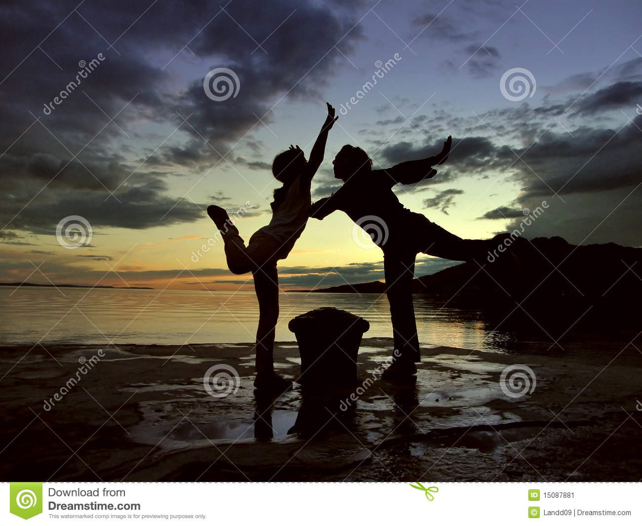 Dancers in sunset at sea