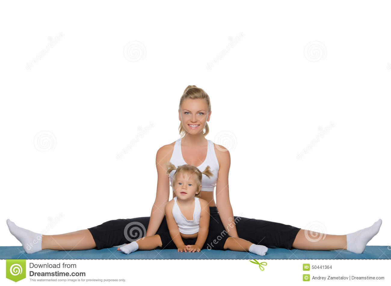 Mom And Daughter Do Gymnastics On Mat Stock Photo Image