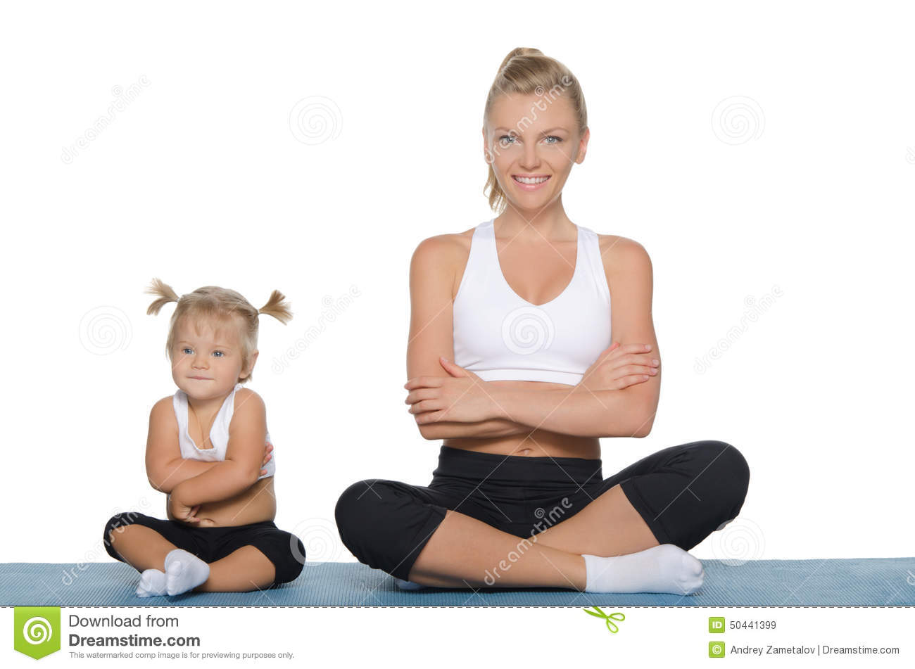 Mom And Daughter Engage In Fitness On Mat Stock Photo