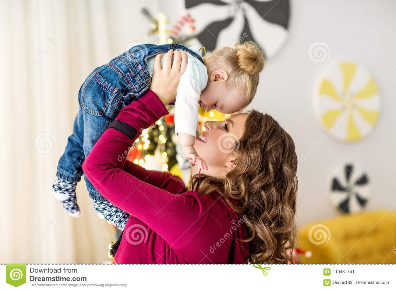 Mom and daughter are at home in the room, Mother`s Day.