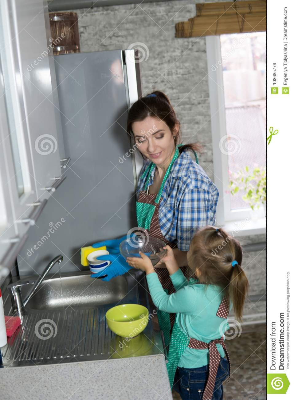 Mom And Daughter Are Washing Dishes In The Kitchen Stock Image ...