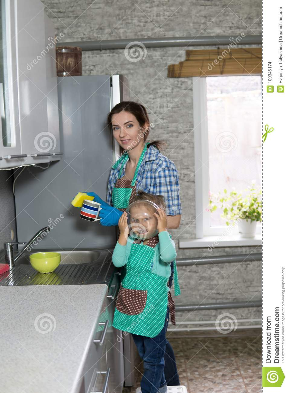 Mom And Daughter Are Washing Dishes In The Kitchen Stock Photo ...
