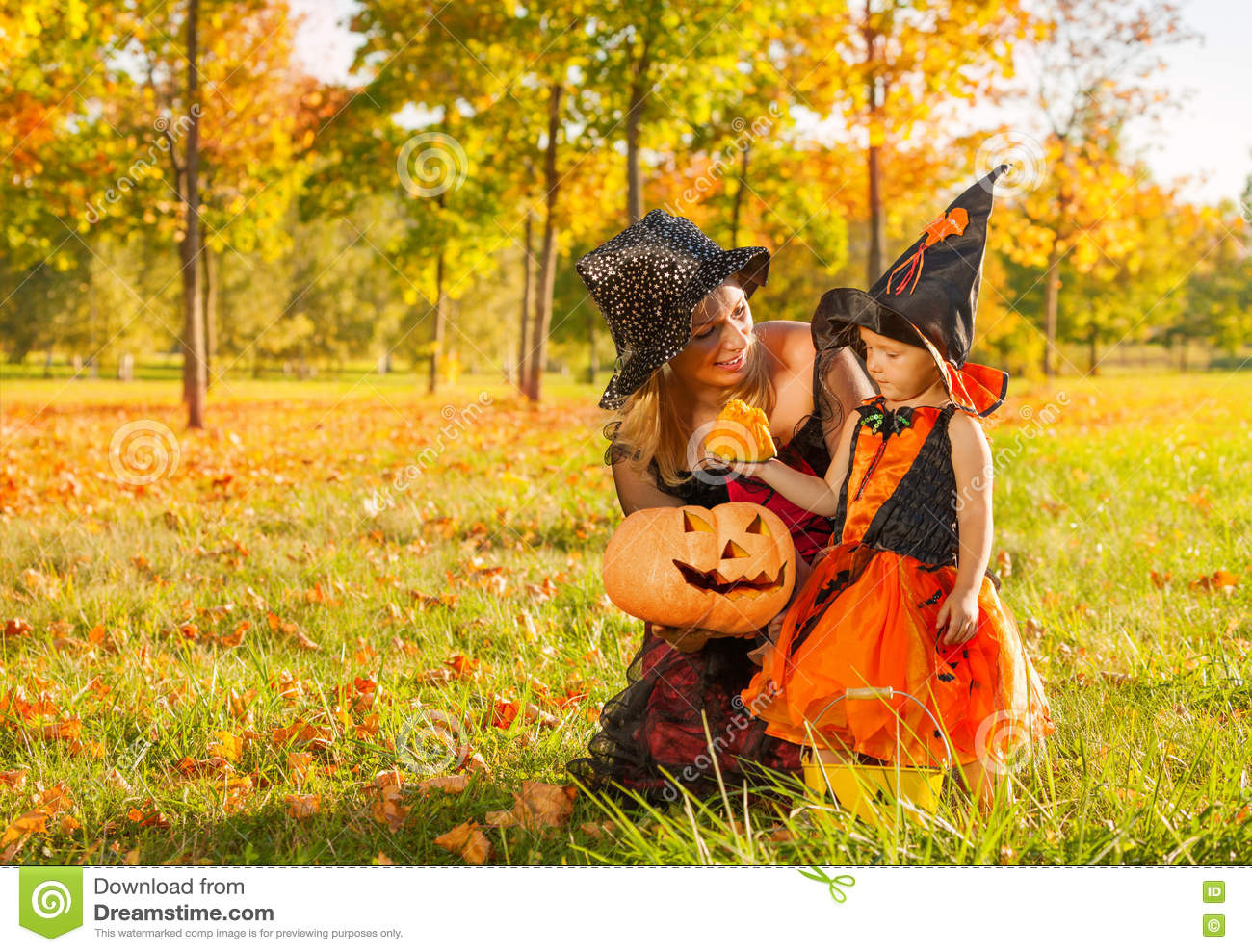 Mom And Daughter In Witches Costumes With Pumpkin Stock Photo ...