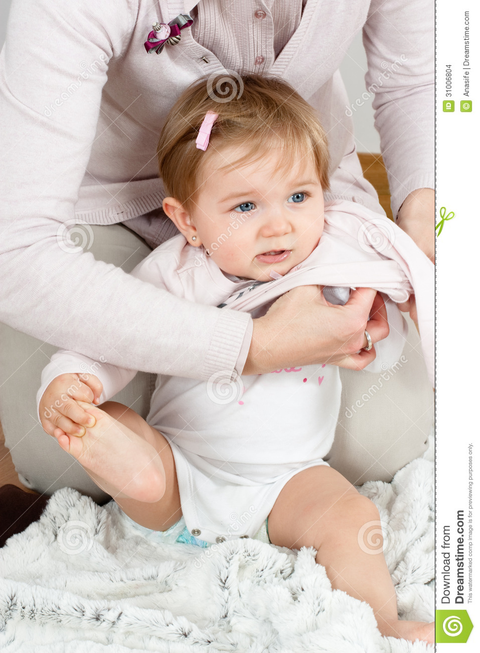 Mom Dressing Up Baby Stock Images - Image: 31006804