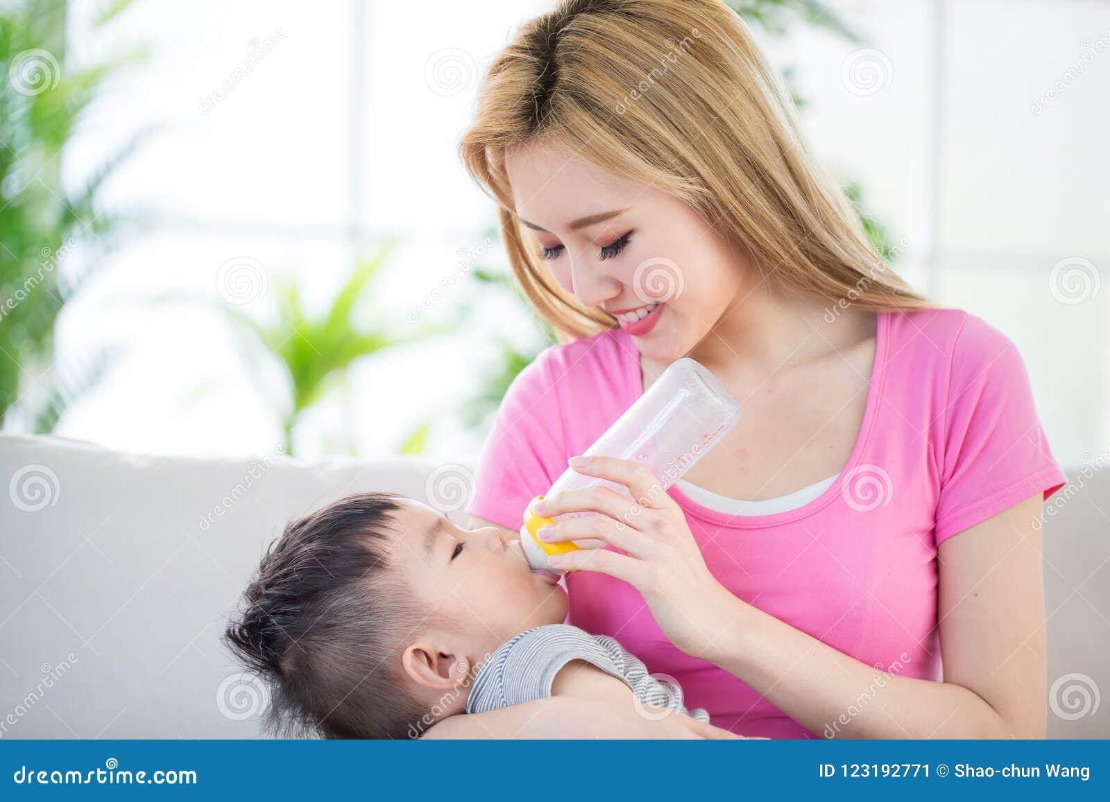 Mom milks sons cock