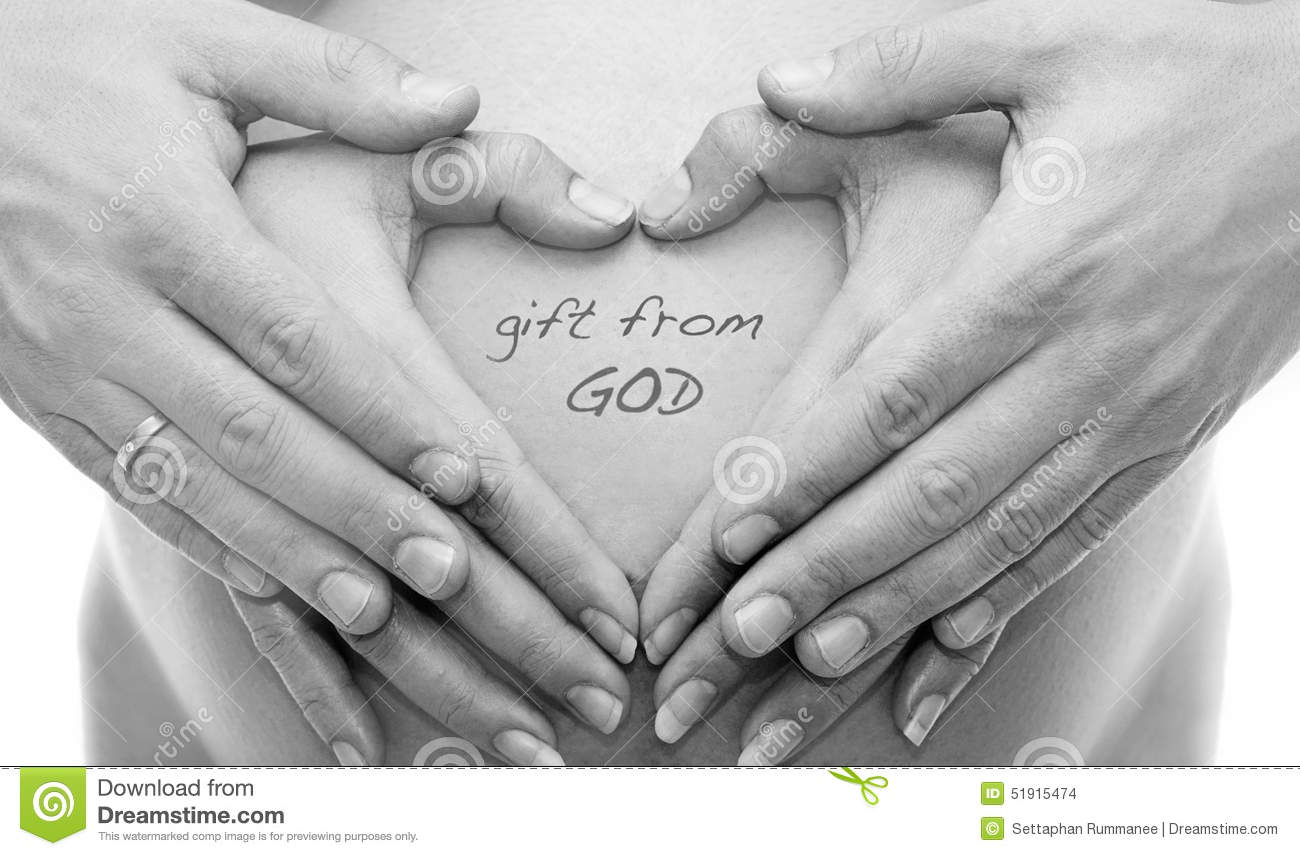 Mom with hand on the baby by heart shape symbol stock photo mom with hand on the baby by heart shape symbol concept abdomen negle Image collections