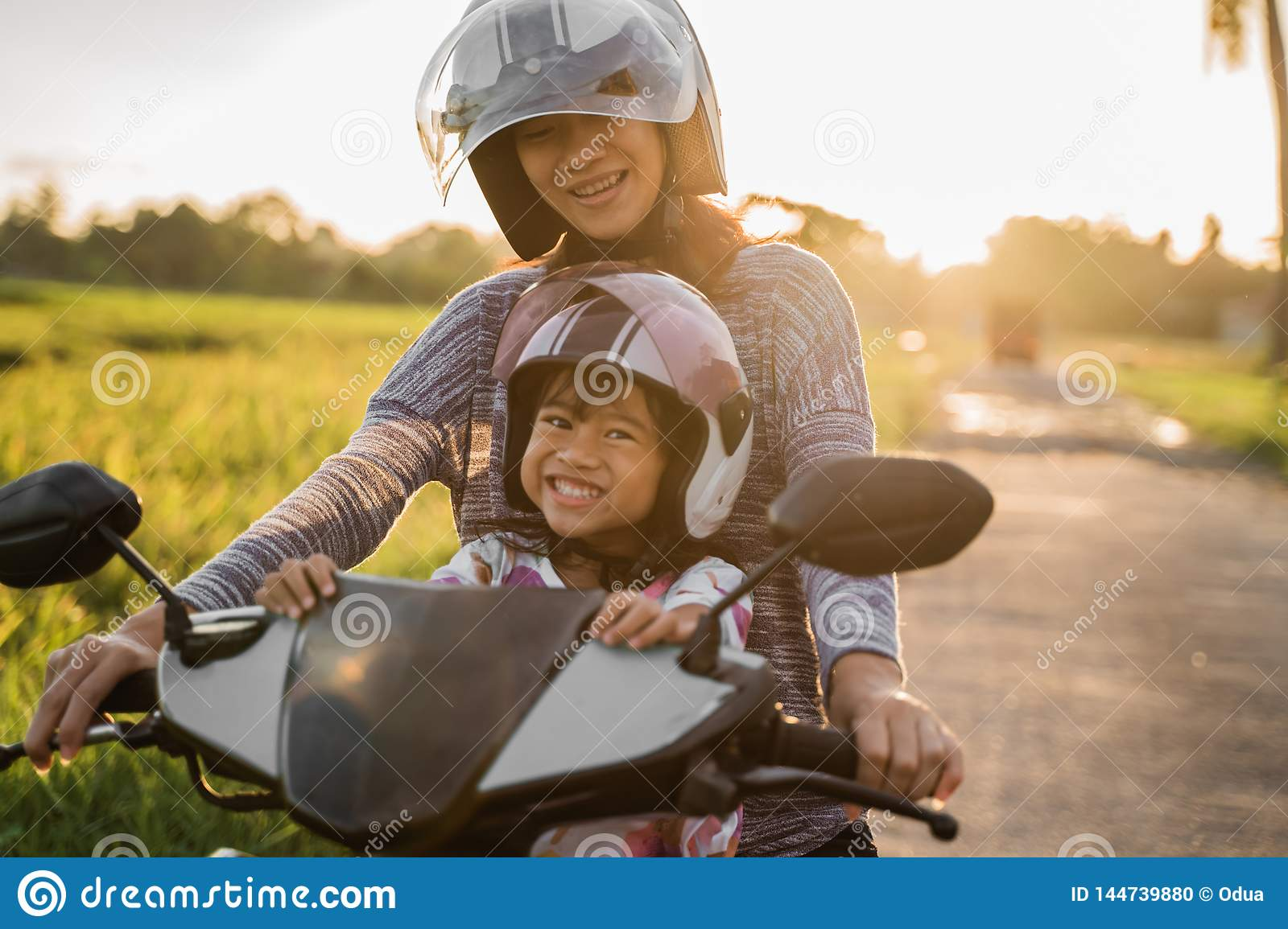 c460f85c457db Mom And Her Child Enjoy Riding Motorcycle Scooter Stock Photo ...