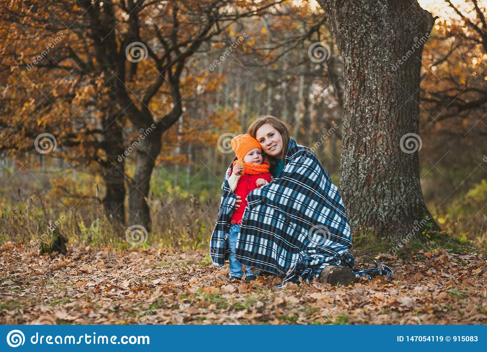 Mom with her daughter in the autumn park