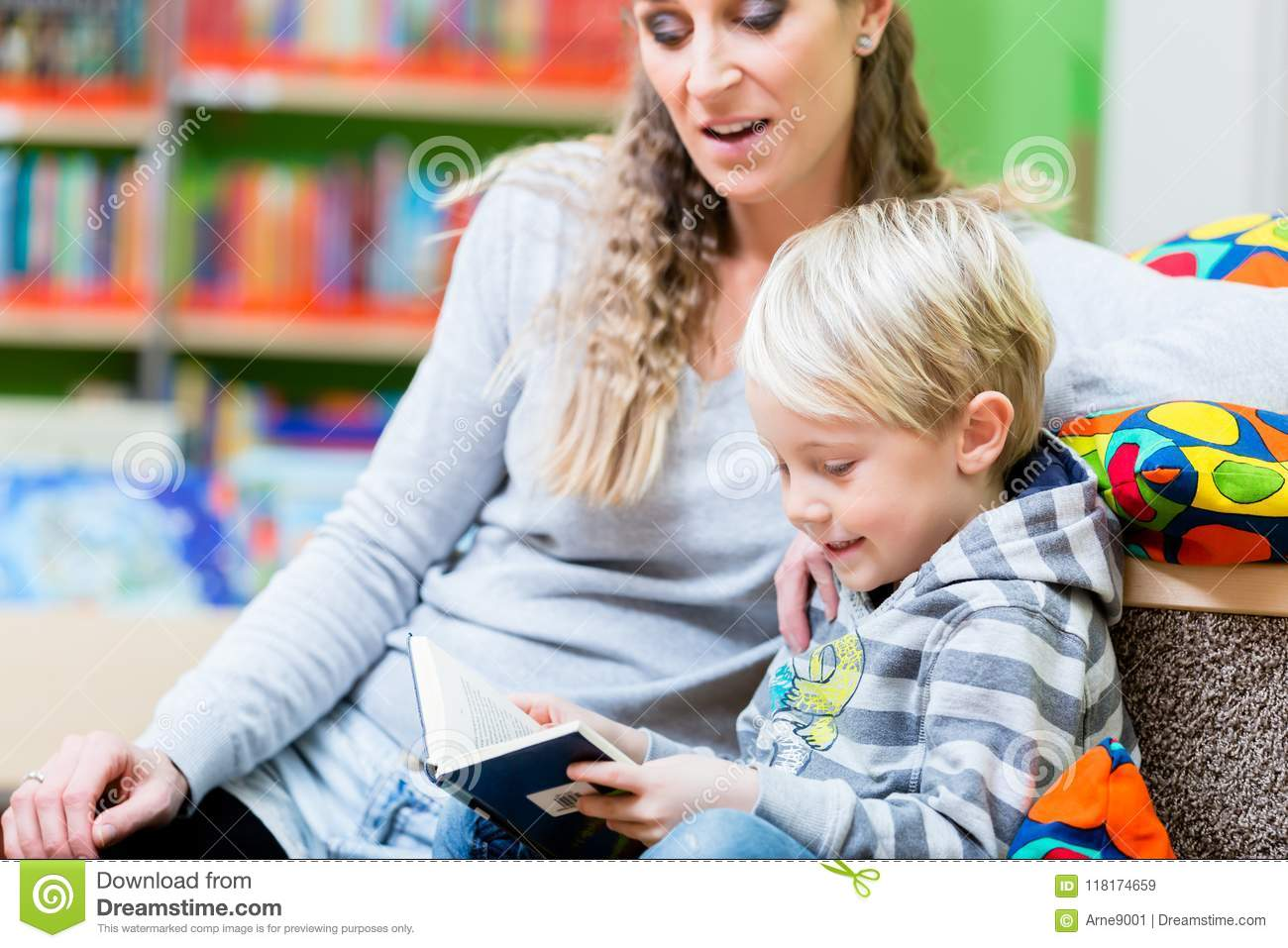 mom with here little son hitting the library the first time stock