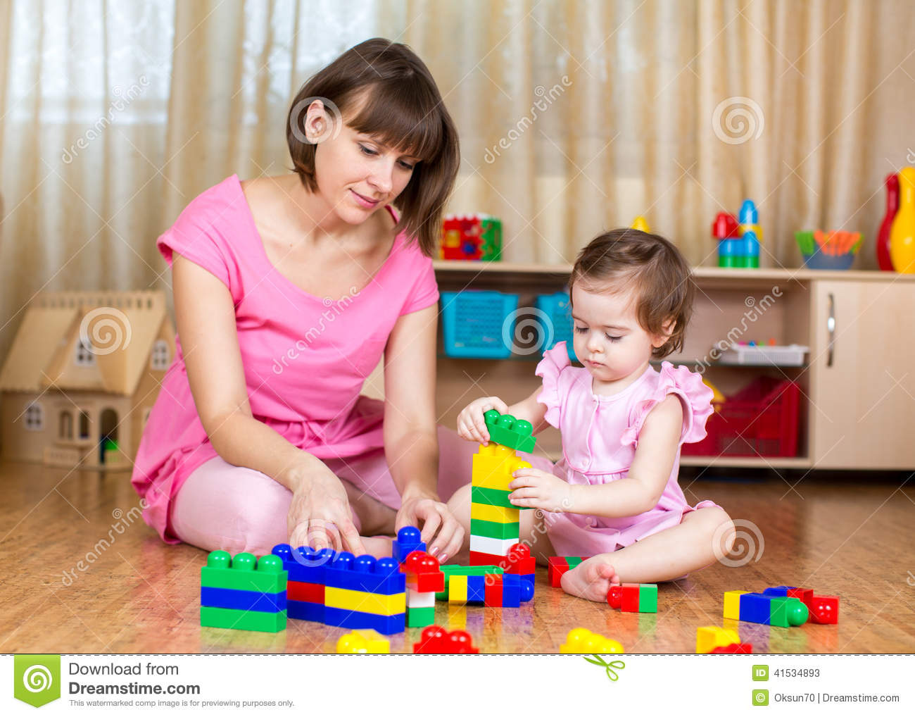 Toys For Developmental Stages : Mom and kid girl play block toys at home stock image