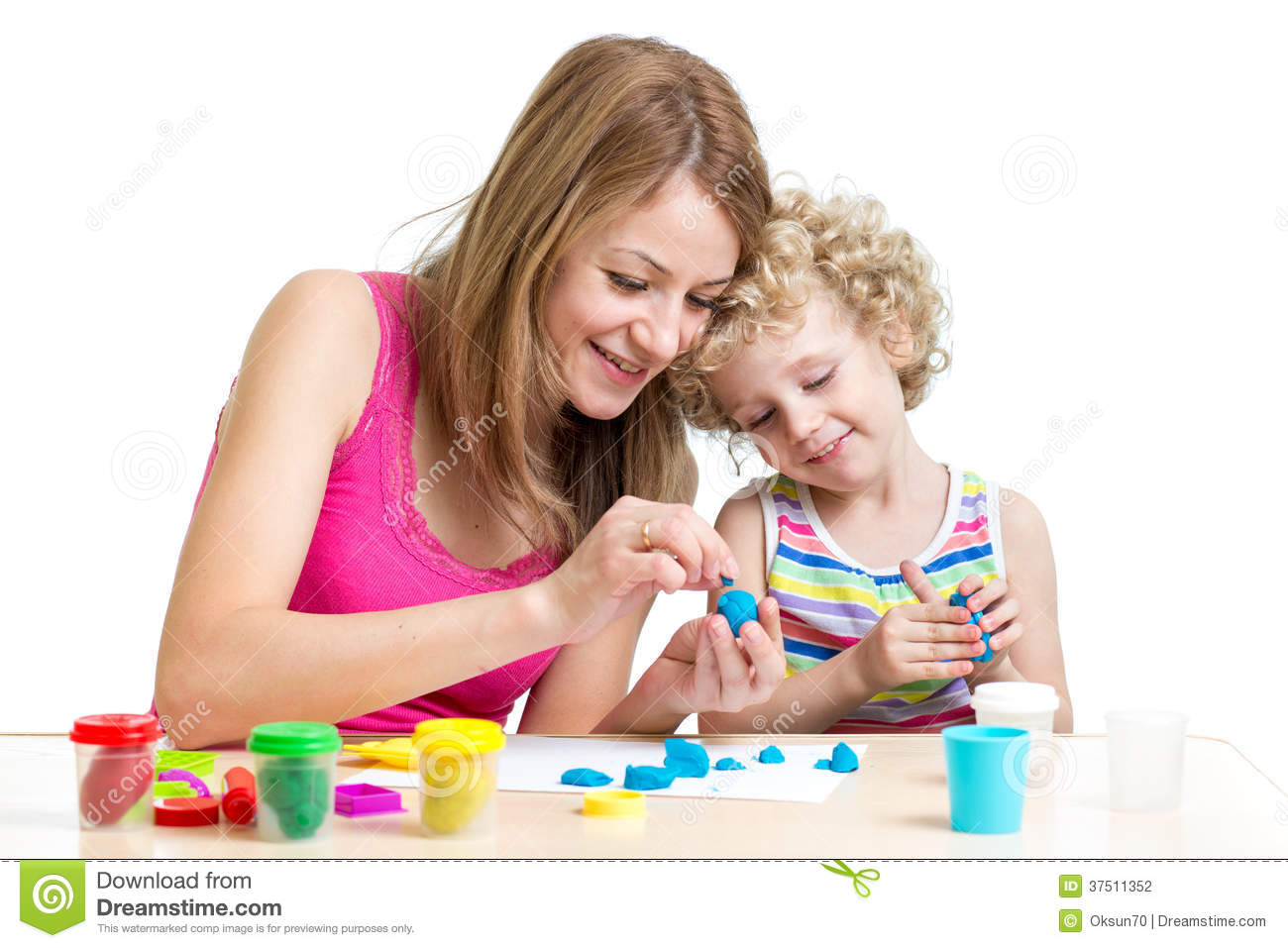 Mom Play Toys : Mom and kid play colorful clay toy stock photography