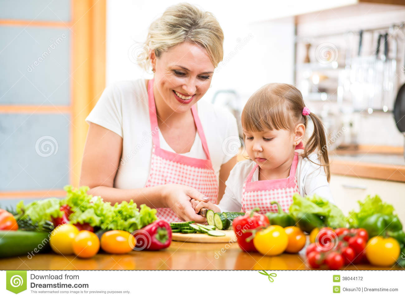 Mom And Kid Preparing Healthy Food Stock Photography - Image: 38044172