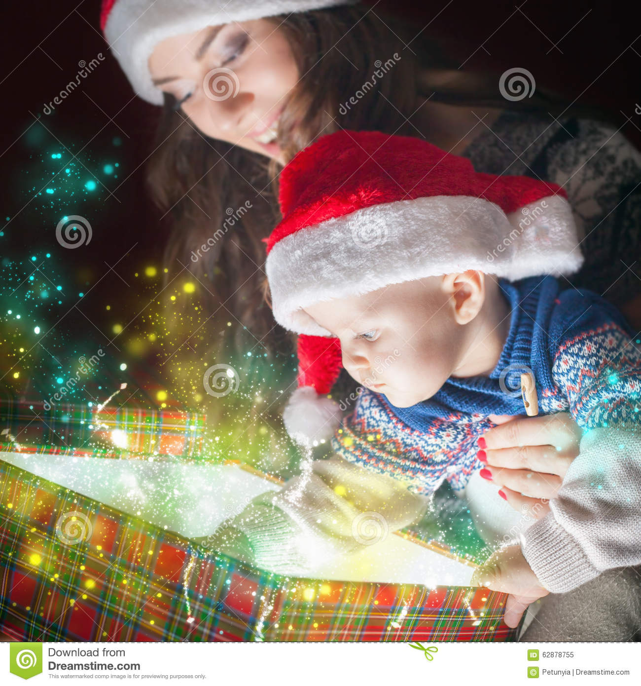 Mom Opens The Magic Box With A Gift For Child Stock Image - Image of ...