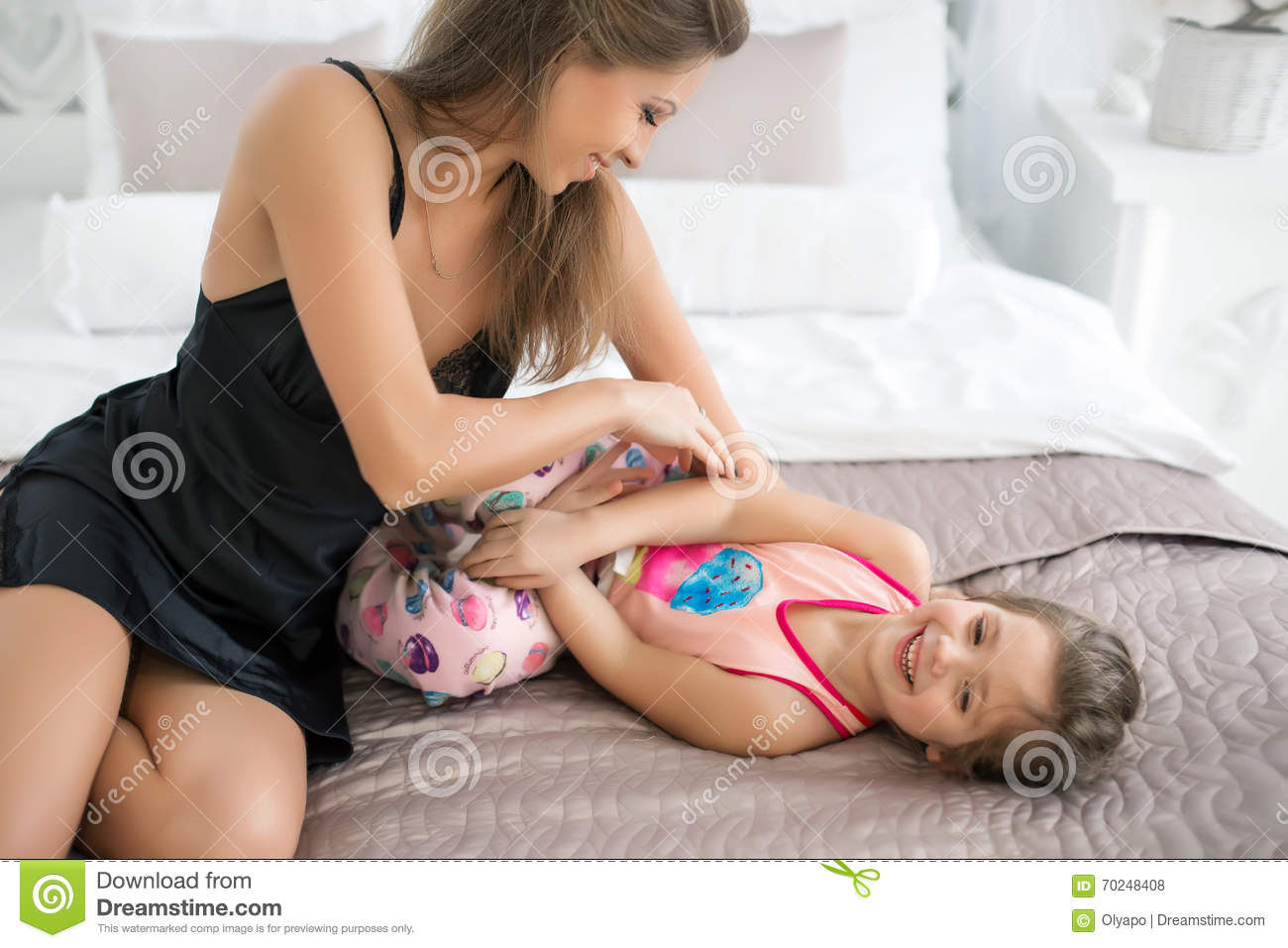 5b048896b6 Mom Plays With Daughter, Tickles Her. Stock Photo - Image of ...