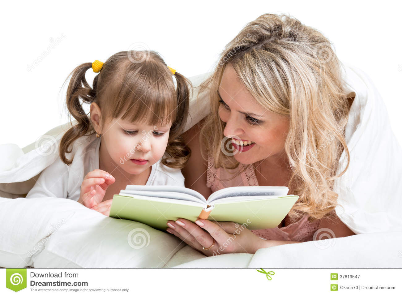 Mom Reading A Book To Kid Lying In The Bed Royalty Free