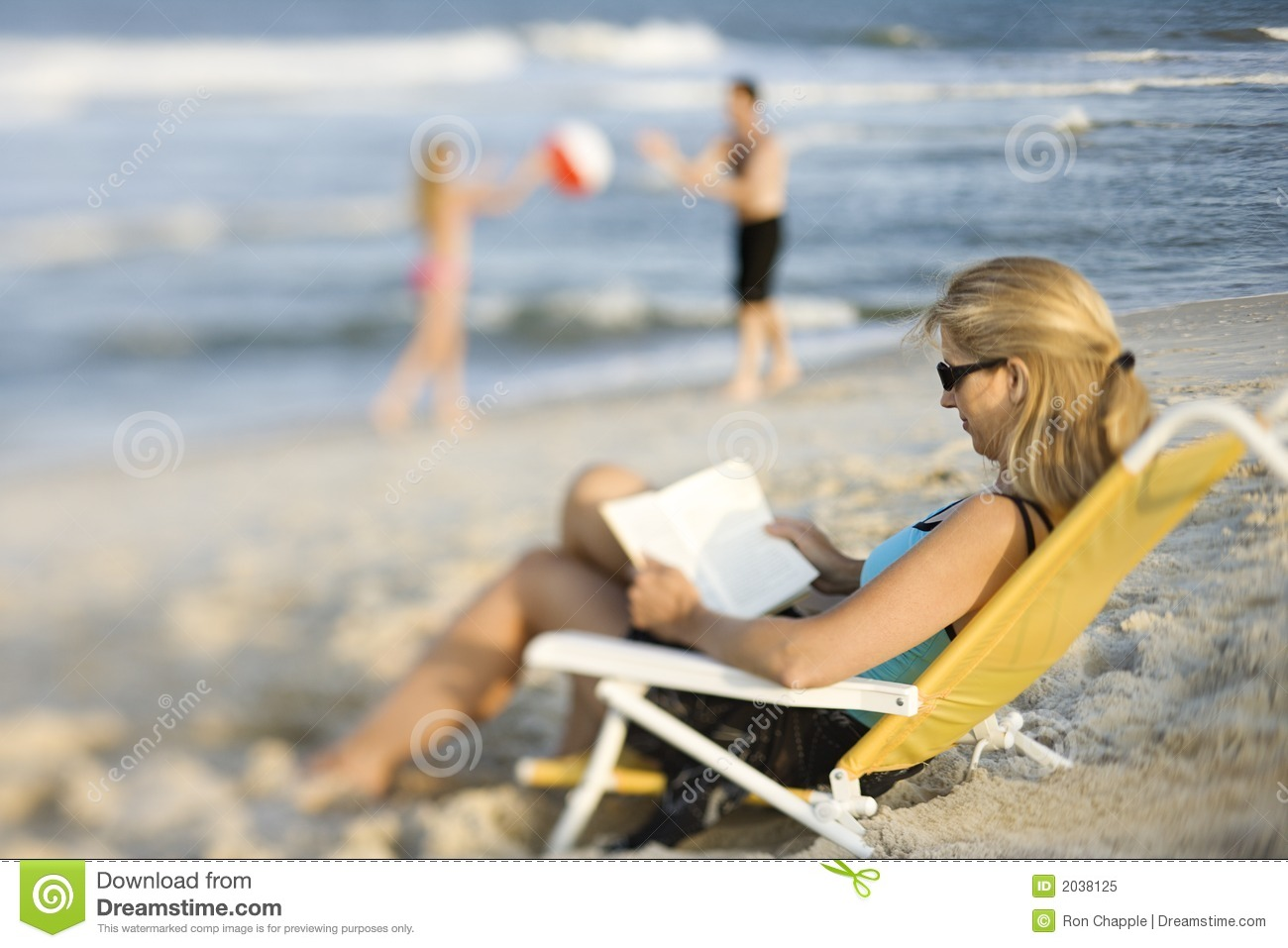 Pleasing Mom Reading In Lounge Chair On Beach Stock Image Image Of Gamerscity Chair Design For Home Gamerscityorg