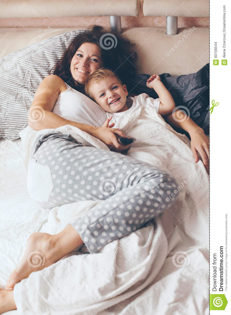 mom relaxing with her little son stock photo image 60156544. Black Bedroom Furniture Sets. Home Design Ideas
