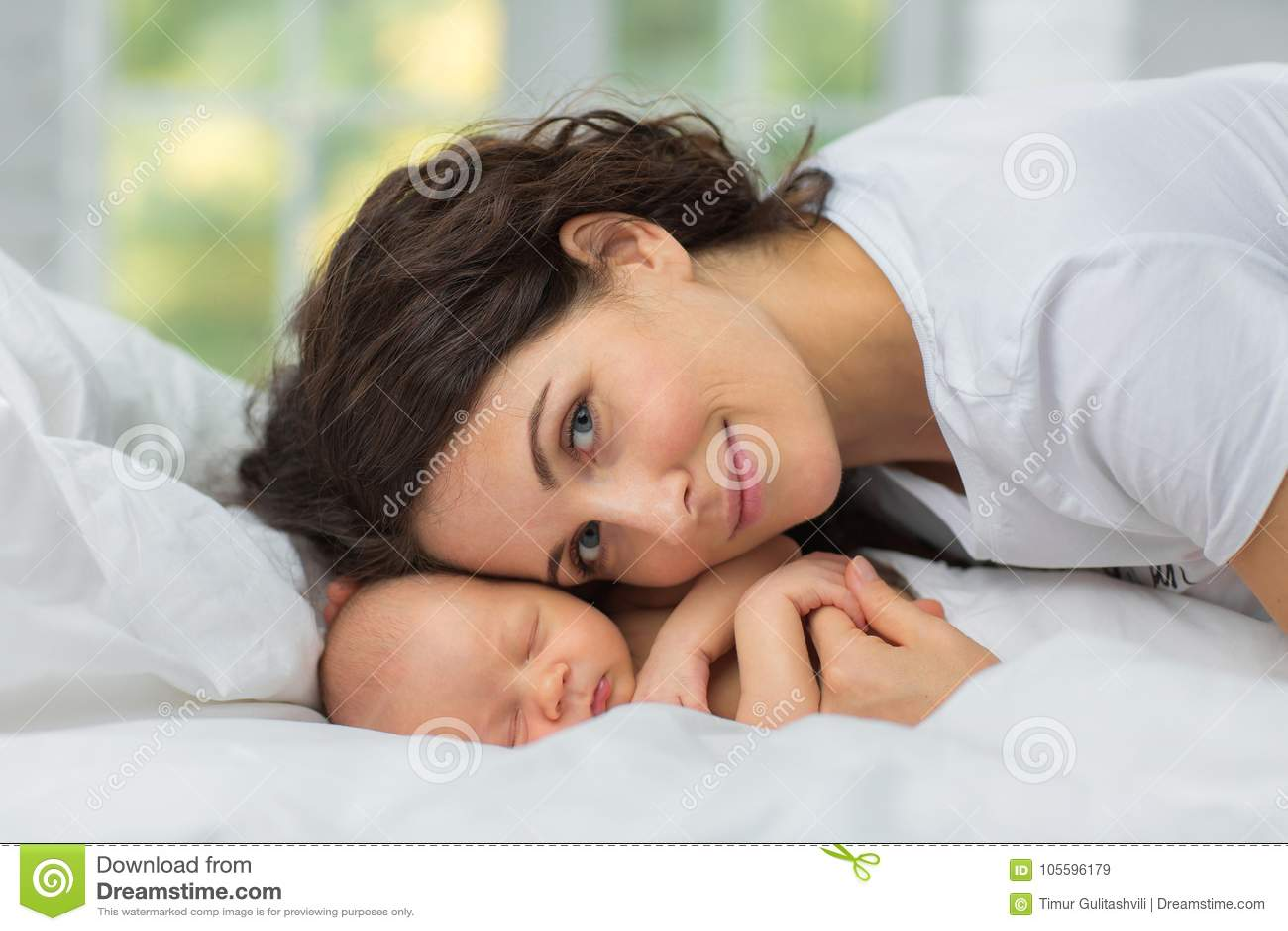 Mom`s love newborn.