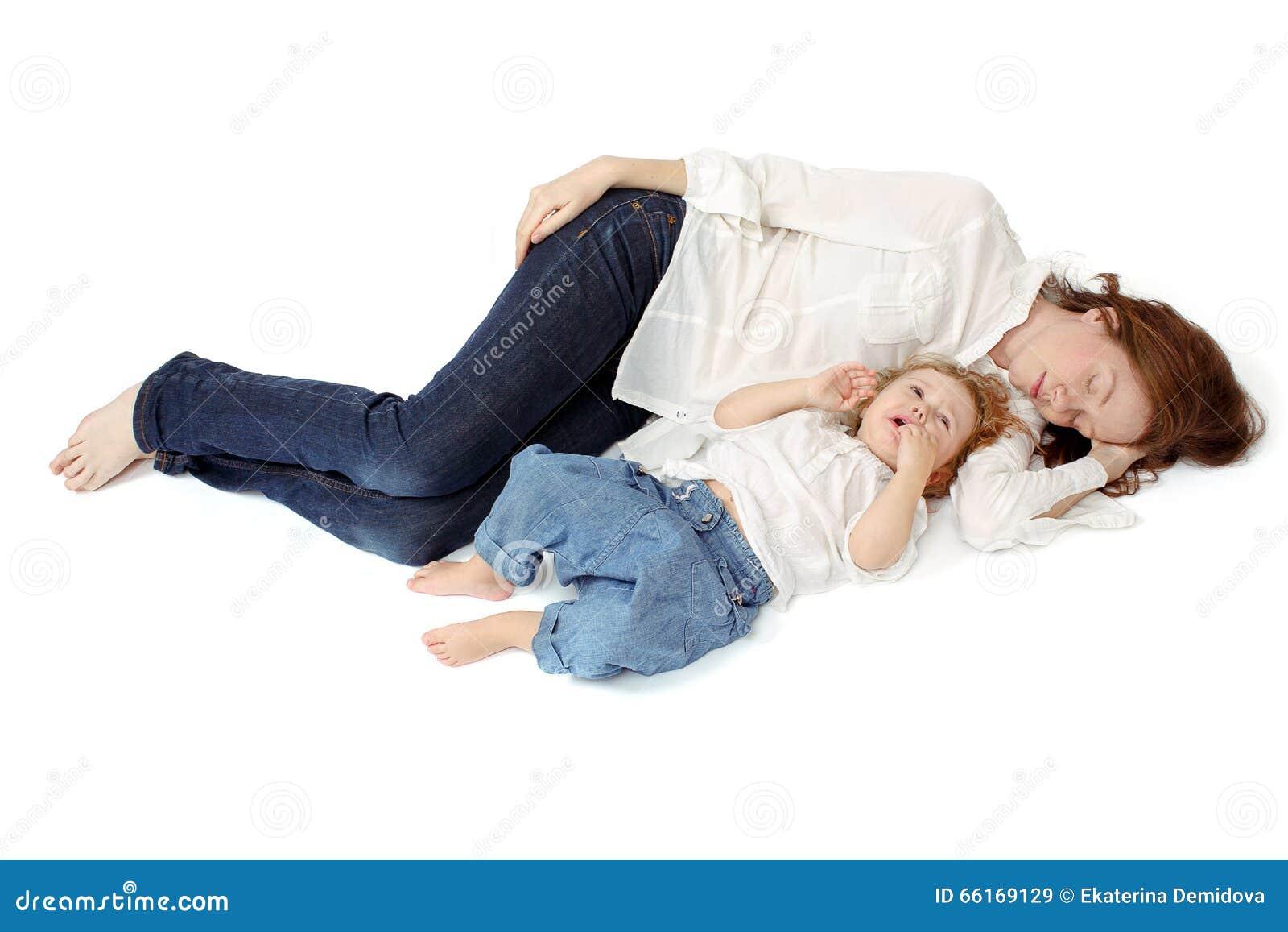 Mom sleeping with her awake child