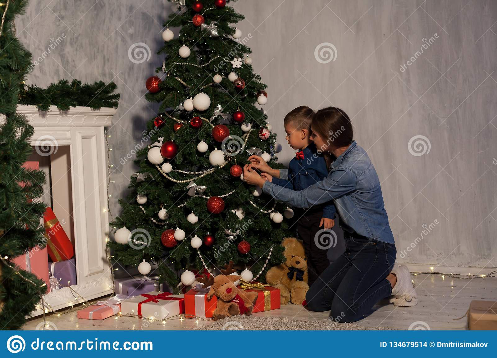 Christmas Gifts For Mom From Son.Mom With Son Adorn The Christmas Tree Lights Christmas New