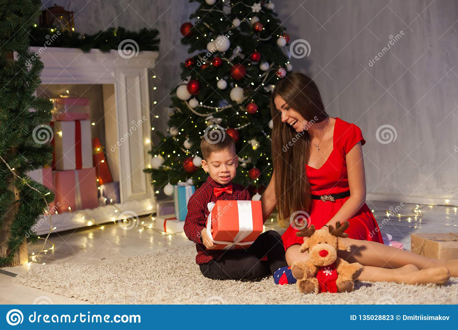 Christmas Gifts For Mom From Son.Mom With Son Decorate Christmas Tree New Year Gifts Garland