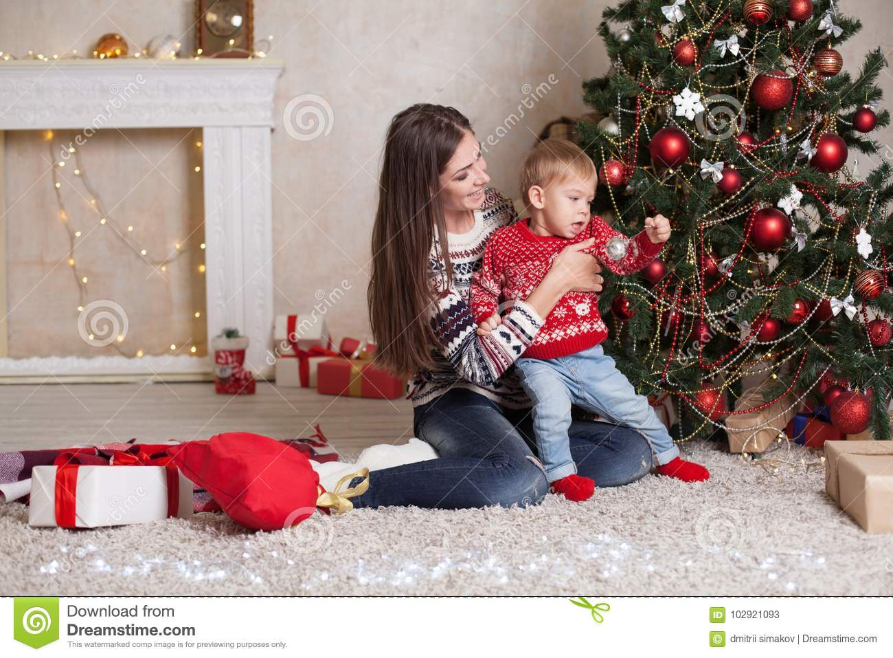 Mom With Son Decorate Tree On New Year`s Gifts Christmas Stock Image ...