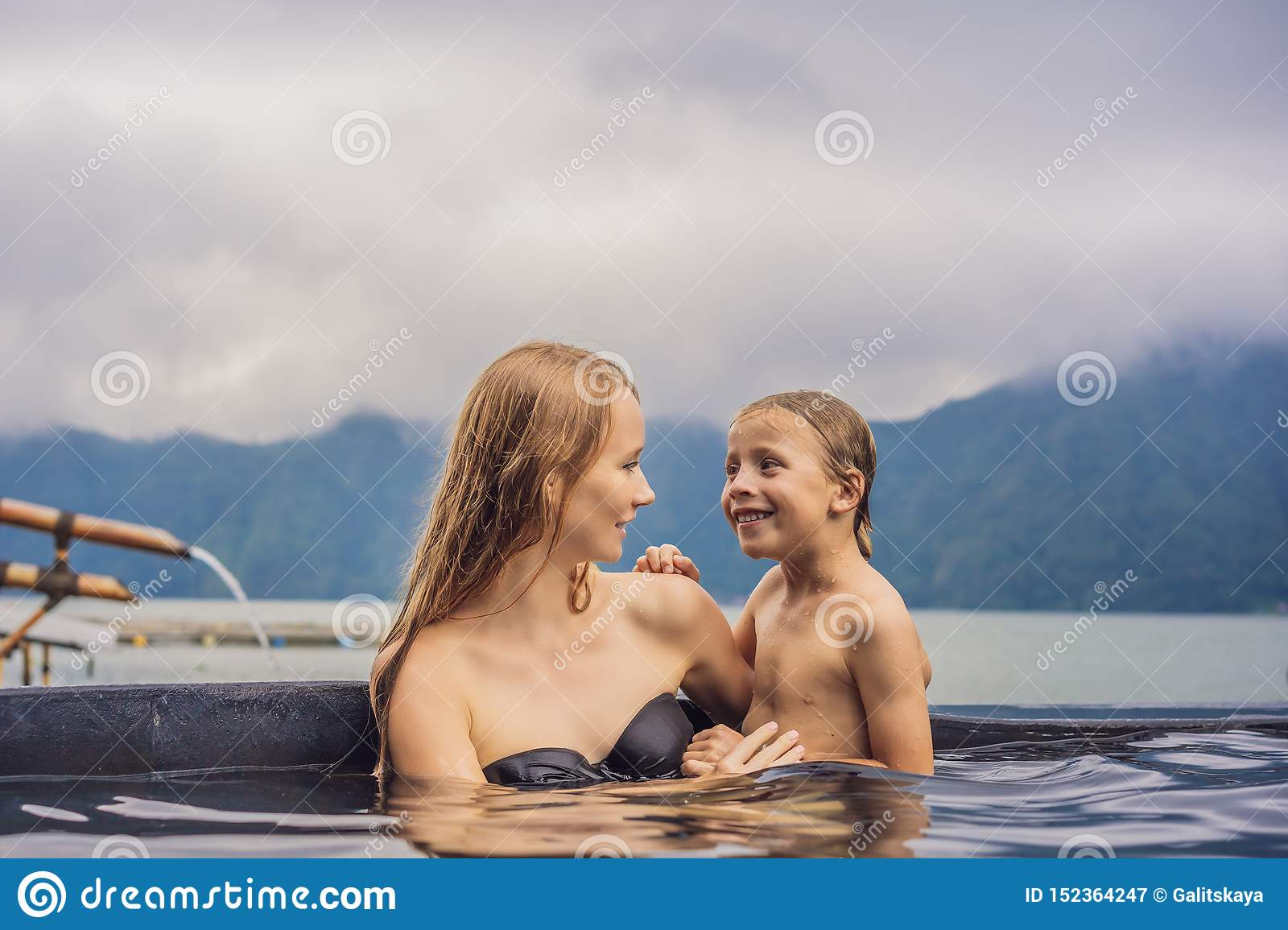 Mom And Son Travelers In Hot Springs In Bali On The Background Of Lake Traveling With Children Concept Stock Image Image Of Nature Pool 152364247