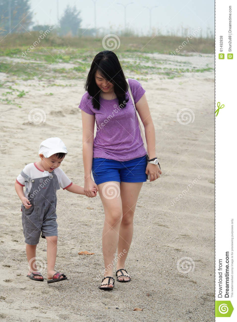 mom and son walking on beach stock photo - image of summer, picnic