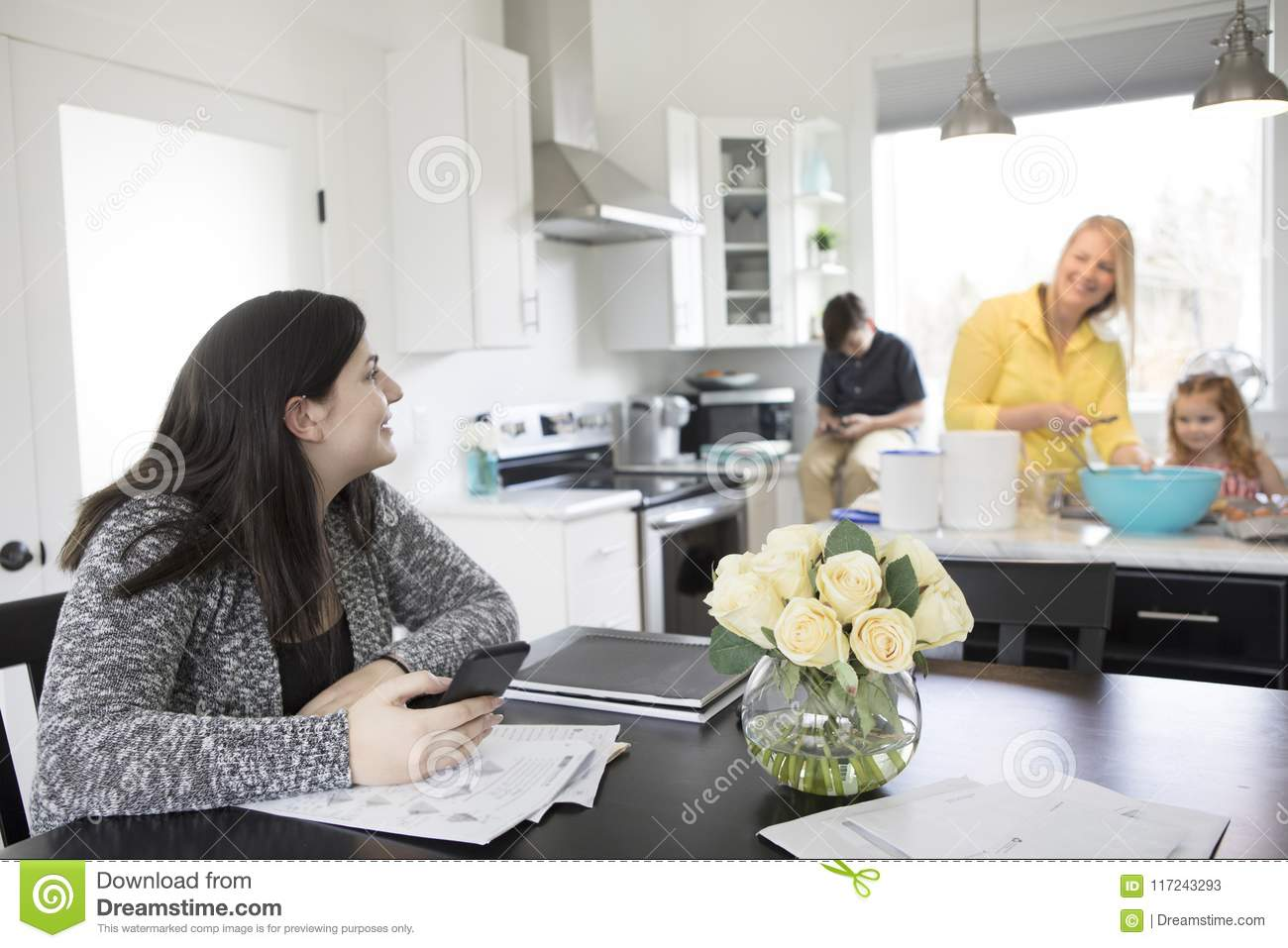 A family baking and spending time together in their modern kitchen.