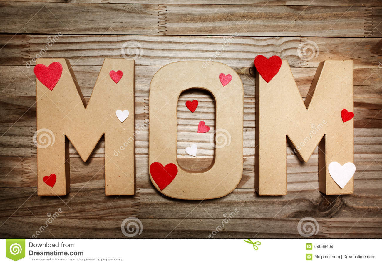 Mom Text In Big Cardboard Letters With Heart Shaped
