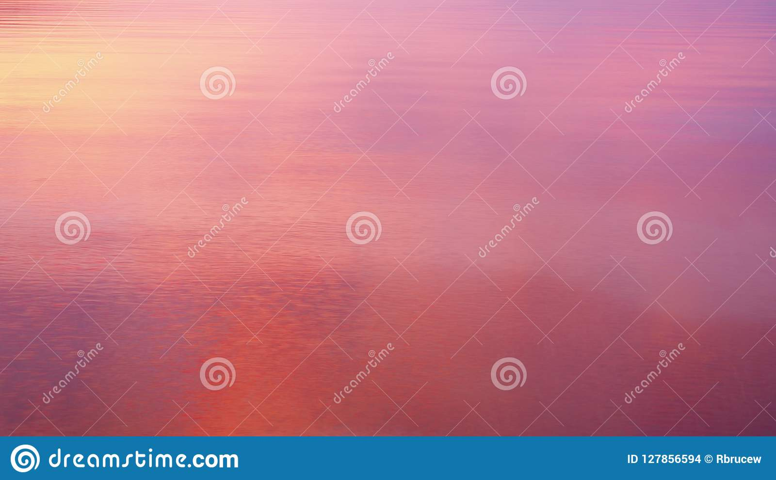 Intense Sunrise Colours Reflected in Calm Sea Water