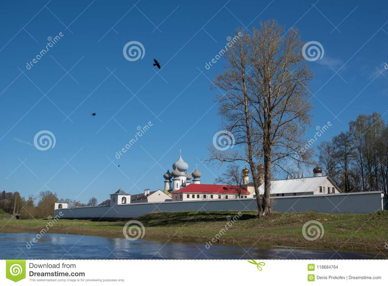 Monastery with white walls over the river