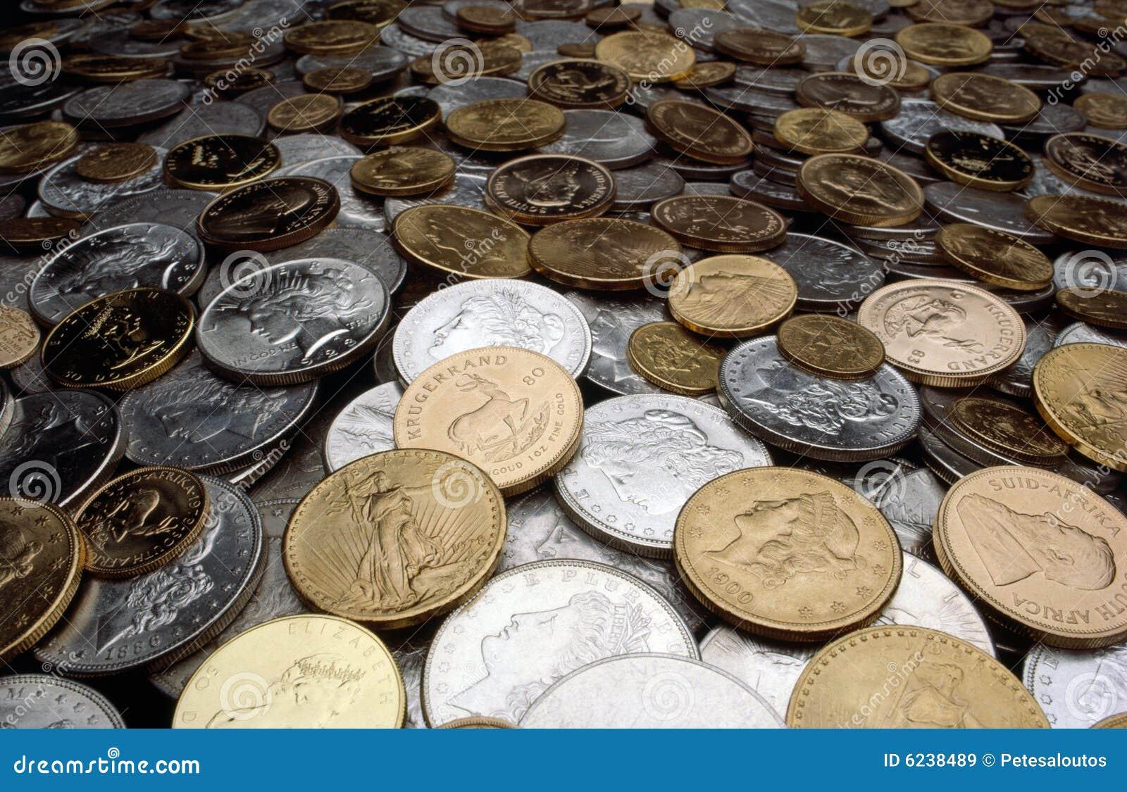 Monedas De La Plata Y De Oro Imagen De Archivo Editorial