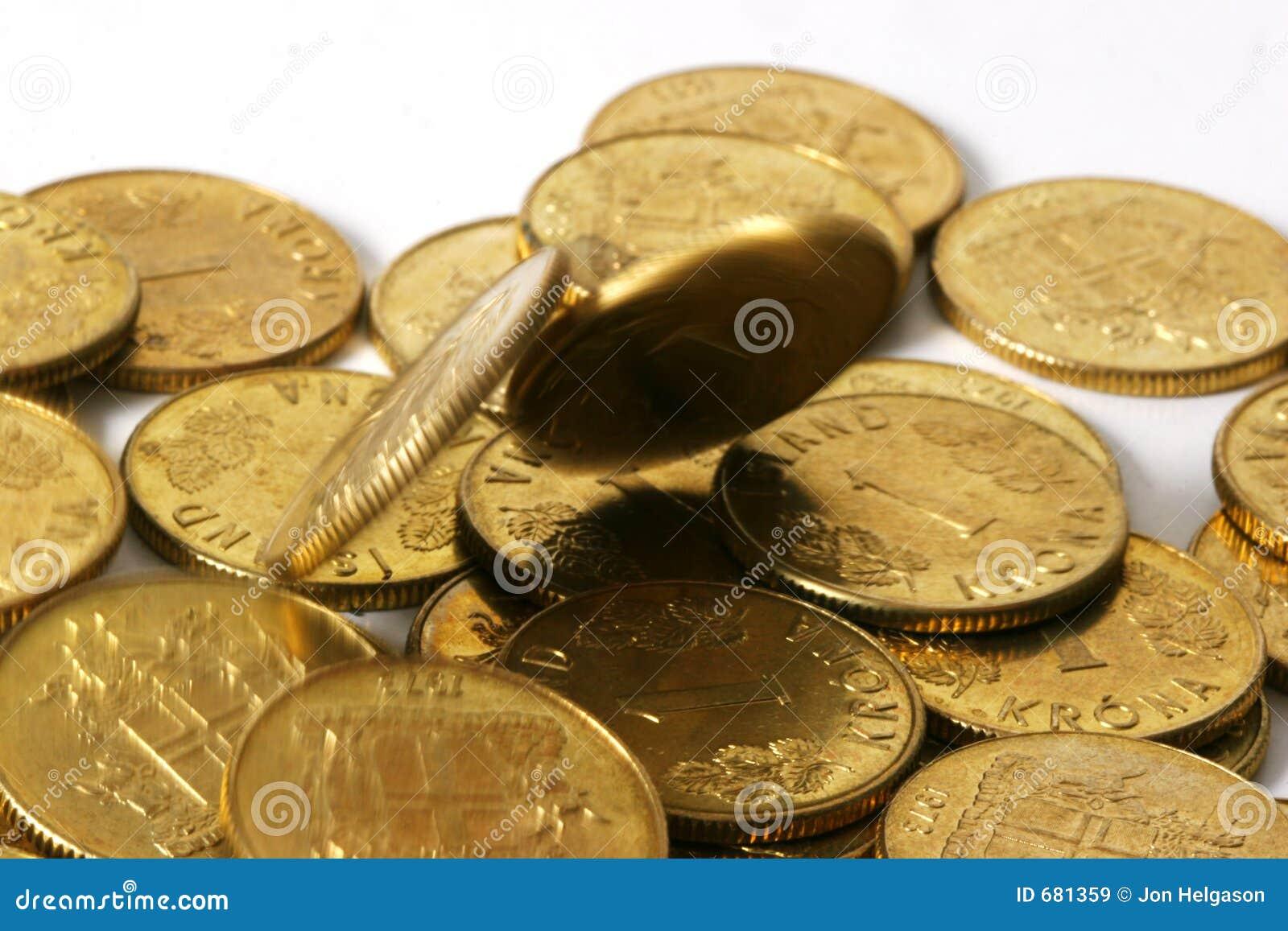 Monedas de oro en el movimiento