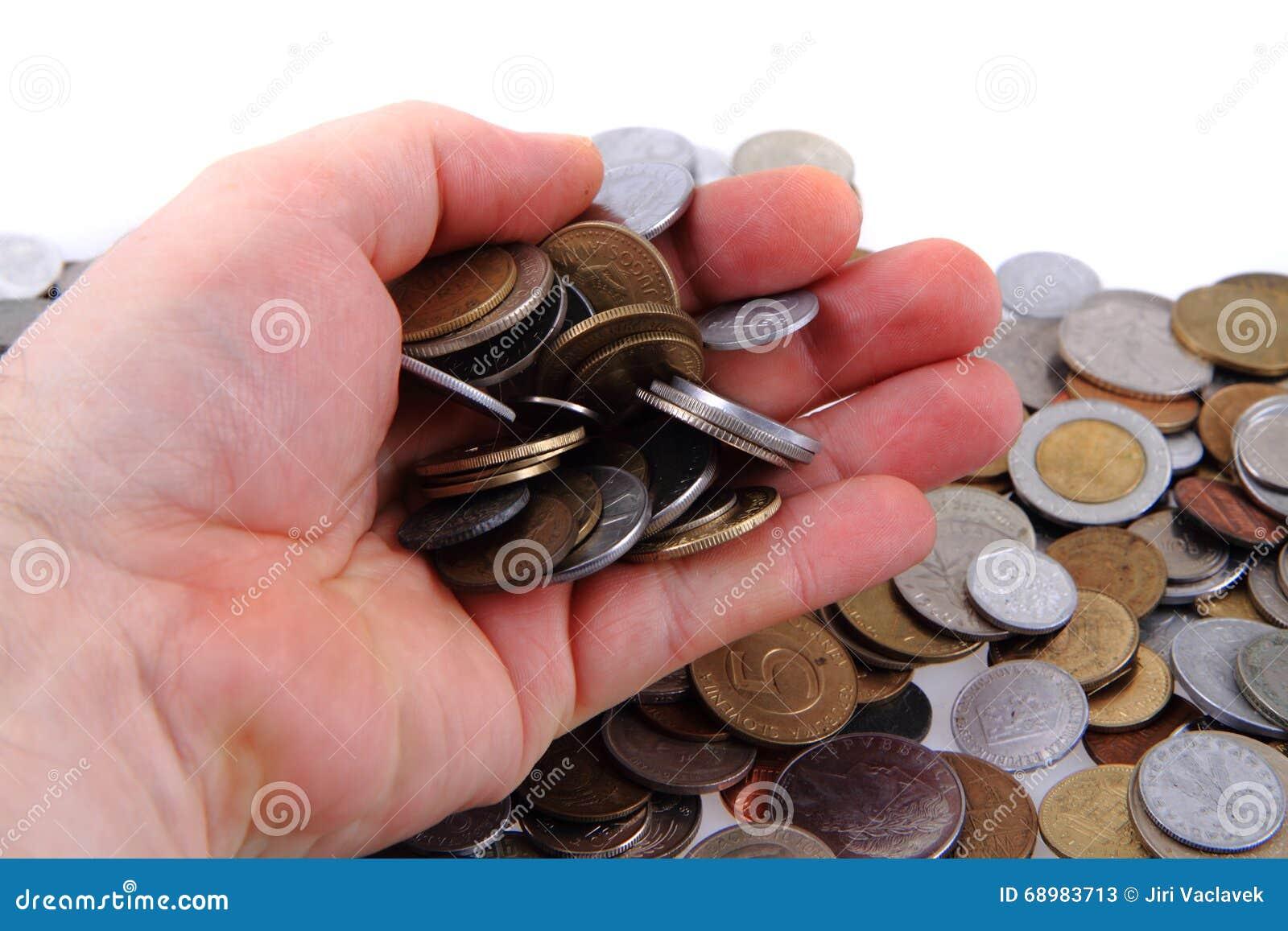 Monedas europeas viejas en mi mano