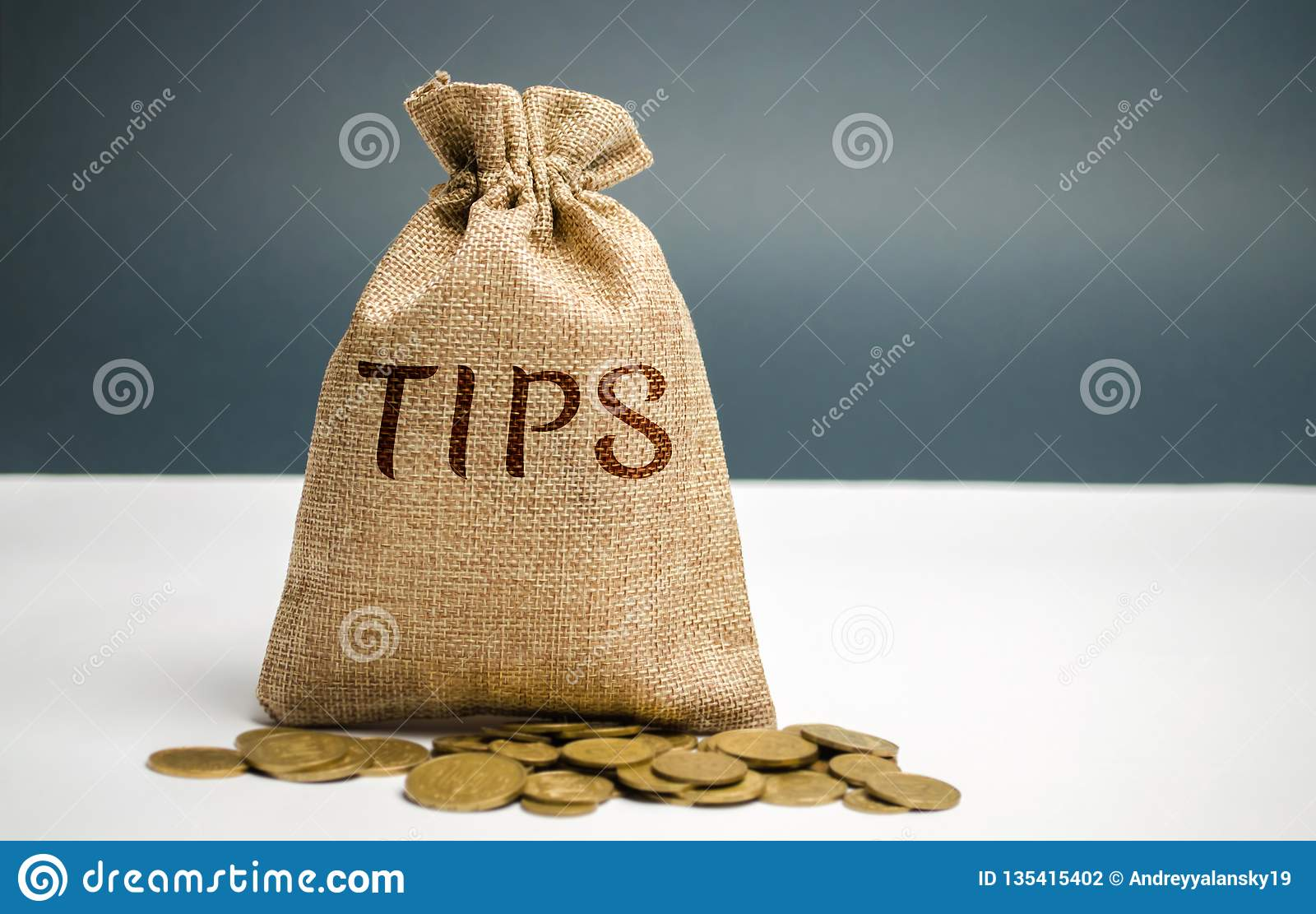Money bag with the word Tips. Award for good service in the cafe / restaurant. A gratuity is a sum of money customarily given by a