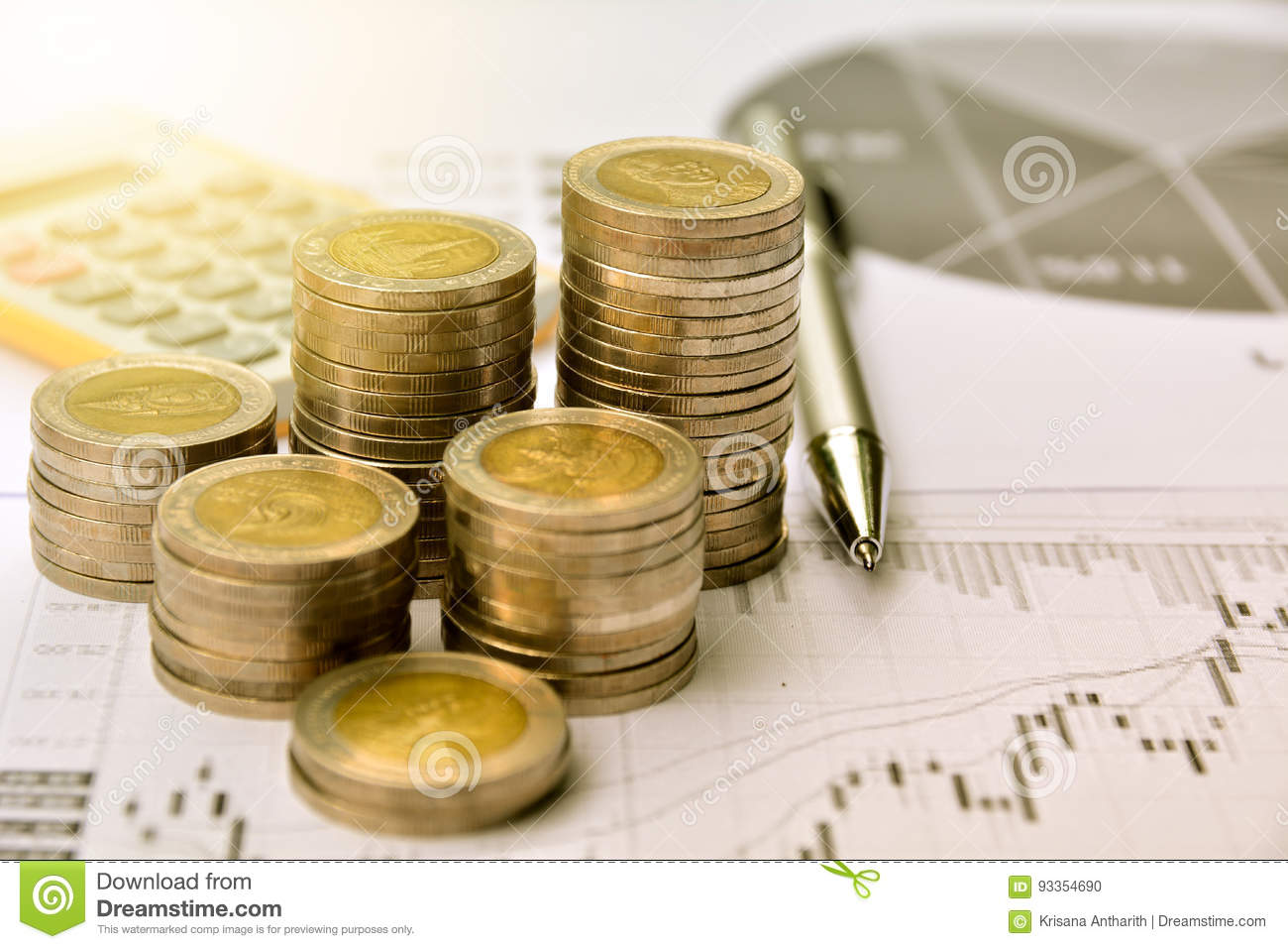 money coins with graph paper and calculator, finance and growth