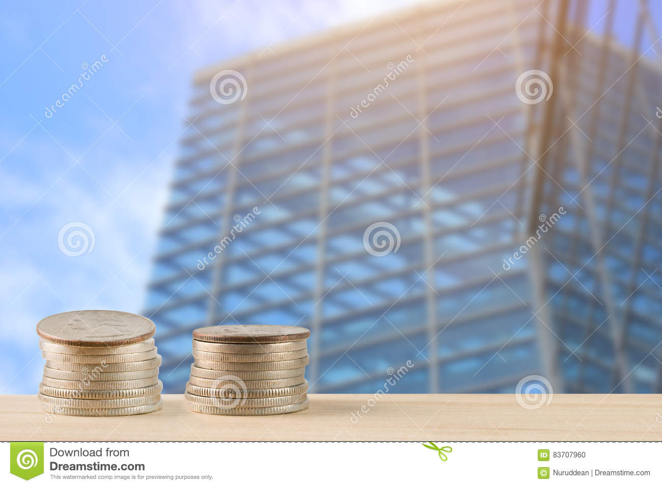 Money Coins Pile On Table With Building In Urban Stock Photo