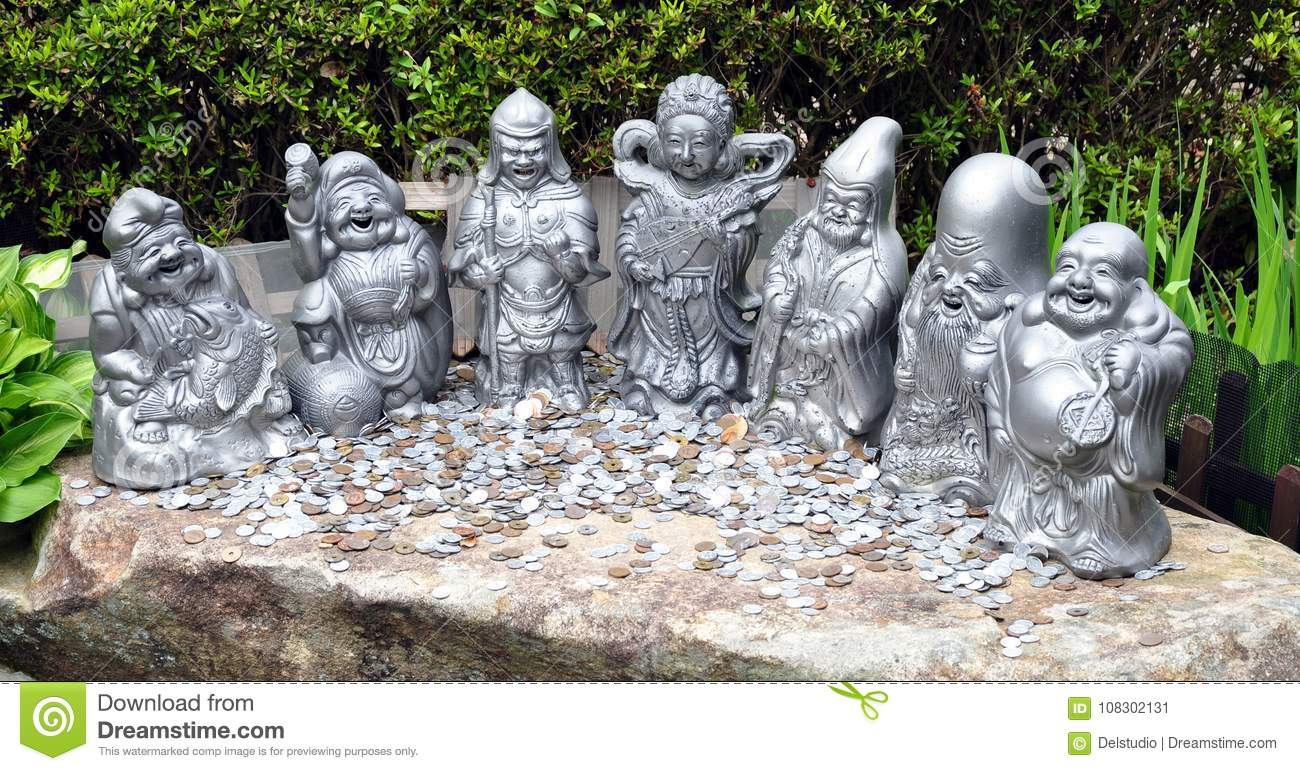 Money coins and Seven lucky gods statues at Daisho-in temple, Miyajima island Japan